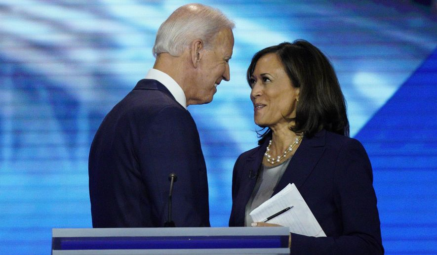 In this Sept. 12, 2019, photo, Democratic presidential candidate former Vice President Joe Biden, left, and then-candidate Sen. Kamala Harris, D-Calif. shake hands after a Democratic presidential primary debate hosted by ABC at Texas Southern University in Houston. Biden has chosen  Harris as his running mate. (AP Photo/David J. Phillip) **FILE**