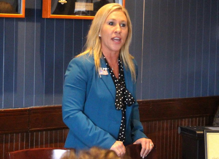In this March 3, 2020, file photo, Republican Marjorie Taylor Greene speaks to a GOP women's group in Rome, Ga. Greene, criticized for promoting racist videos and adamantly supporting the far-right QAnon conspiracy theory, has won the GOP nomination for northwest Georgia's 14th Congressional District. (John Bailey/Rome News-Tribune via AP, File)