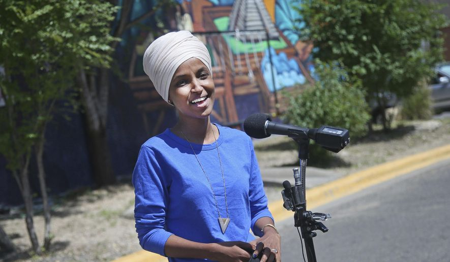 Democrat Rep. Ilhan Omar addresses media after lunch at the Mercado Central in Minneapolis Tuesday, Aug. 11, 2020, primary Election Day in Minnesota. (AP Photo/Jim Mone)