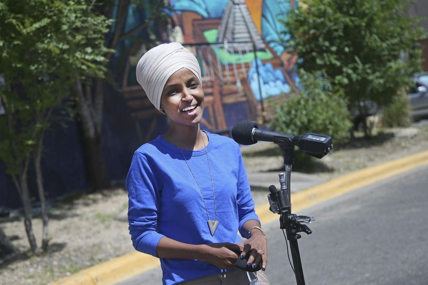 Democrat Rep. Ilhan Omar addresses media after lunch at the Mercado Central in Minneapolis Tuesday, Aug. 11, 2020, primary Election Day in Minnesota. (AP Photo/Jim Mone) ** FILE **
