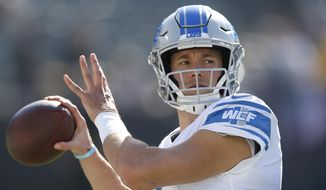 In this Nov. 3, 2019, file photo, Detroit Lions quarterback Matthew Stafford warms up before an NFL football game against the Oakland Raiders in Oakland, Calif. Since the start of last year, Matthew Stafford has had to deal with a health scare involving his wife, his own injury problems -- and more recently, a coronavirus test that the team later described as a false positive. It's been a difficult period for the Detroit star. (AP Photo/D. Ross Cameron, File) **FILE**