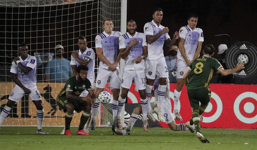 Orlando players block a free kick by Portland Timbers midfielder Diego Valeri (8), during the second half of an MLS soccer match, Tuesday, Aug. 11, 2020, in Kissimmee, Fla. (AP Photo/John Raoux)
