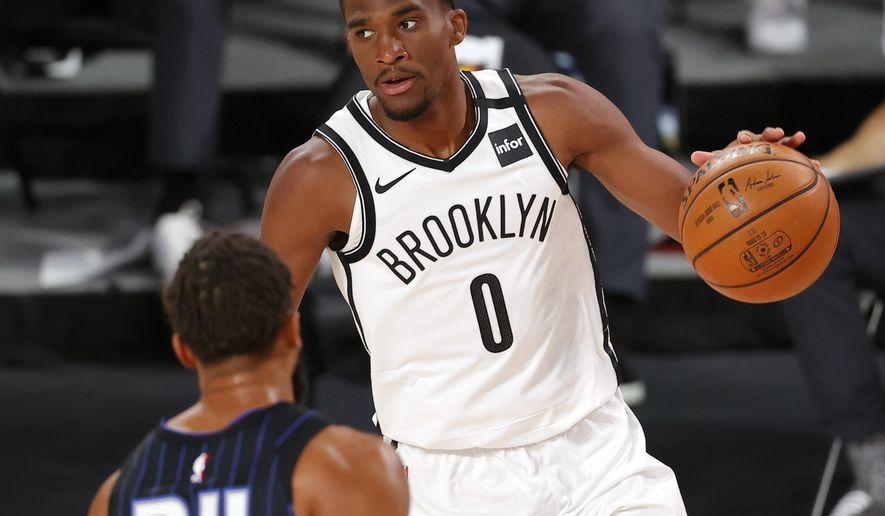 Brooklyn Nets' Jeremiah Martin (0) moves the ball against the Orlando Magic during the first half at of an NBA basketball game Tuesday, Aug. 11, 2020, in Lake Buena Vista, Fla. (Mike Ehrmann/Pool Photo via AP)