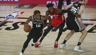 San Antonio Spurs forward DeMar DeRozan (10) drives past Houston Rockets forward Robert Covington (33) off a screen by center Jakob Poeltl (25) during the second half of a NBA basketball game Tuesday, Aug. 11, 2020, in Lake Buena Vista, Fla. (Kim Klement/Pool Photo via AP)