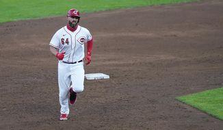 Cincinnati Reds first baseman Matt Davidson (64) runs the bases after hitting a two run home run during the third inning of a baseball game against the Kansas City Royals at Great American Ballpark in Cincinnati, Tuesday, Aug. 11, 2020. (AP Photo/Bryan Woolston)