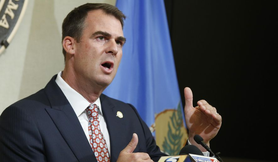In this July 9, 2020 file photo, Oklahoma Gov. Kevin Stitt speaks during a news conference in Oklahoma City. Stitt, the first governor in the nation to test positive for the coronavirus, says he has donated plasma to help other virus patients recover. Stitt said in a statement Tuesday, Aug. 11th that he made the donation recently at an Oklahoma Blood Institute center in Enid. (AP Photo/Sue Ogrocki, File)  **FILE**