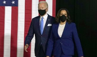 Democratic presidential candidate former Vice President Joe Biden and his running mate Sen. Kamala Harris, D-Calif., arrive to speak during a news conference at Alexis Dupont High School in Wilmington, Del., Wednesday, Aug. 12, 2020. (AP Photo/Carolyn Kaster)
