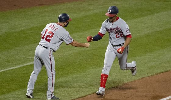 Washington Nationals left fielder Juan Soto (22) celebrates with third base coach Chip Hale (12) after hitting a home run during the sixth inning of a baseball game against the New York Mets Wednesday, Aug. 12, 2020, in New York. (AP Photo/Frank Franklin II)