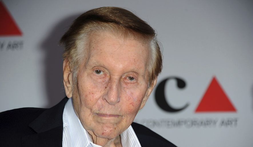 In this April 20, 2013, file photo, media mogul Sumner Redstone arrives at the 2013 MOCA Gala celebrating the opening of the Urs Fischer exhibition at MOCA, in Los Angeles. Redstone, the strong-willed media mogul whose public disputes with family members and subordinates made him a feared operator in Hollywood, died Wednesday, Aug. 12, 2020. (Photo by Richard Shotwell/Invision/AP, File)