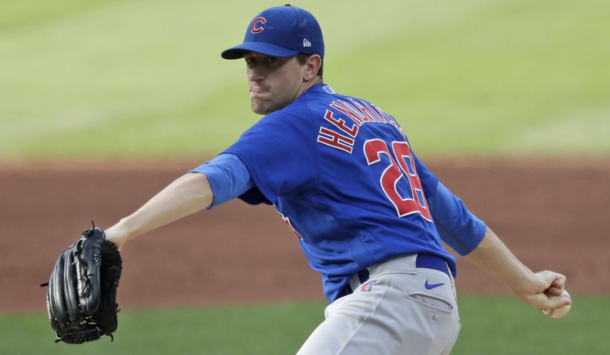 Chicago Cubs starting pitcher Kyle Hendricks delivers in the first inning in a baseball game against the Cleveland Indians, Wednesday, Aug. 12, 2020, in Cleveland. (AP Photo/Tony Dejak)