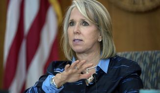 In this July 23, 2020, file photo, New Mexico Gov. Michelle Lujan Grisham gives her weekly update on COVID-19 in New Mexico iin Santa Fe, N.M. (Eddie Moore/The Albuquerque Journal via AP)  **FILE**