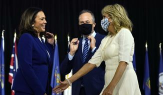 Sen. Kamala Harris, D-Calif., and her husband Douglas Emhoff greet Jill Biden, wife of Democratic presidential candidate former Vice President Joe Biden, after a campaign event at Alexis Dupont High School in Wilmington, Del., Wednesday, Aug. 12, 2020. (AP Photo/Carolyn Kaster) **FILE**