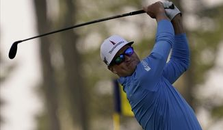 Zach Johnson watches his tee shot on the seventh hole during the second round of the PGA Championship golf tournament at TPC Harding Park Friday, Aug. 7, 2020, in San Francisco. (AP Photo/Jeff Chiu)