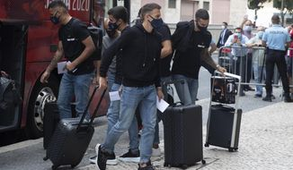 Atletico's Madrid players arrive to the team hotel in Lisbon, Portugal, Tuesday, Aug. 11, 2020. Atletico are scheduled to play Leipzig in a Champions League Quarter Final soccer match on Thursday. (AP Photo/Manu Fernandez)