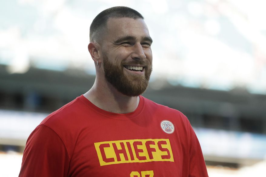 FILE - Kansas City Chiefs' Travis Kelce smiles before the NFL Super Bowl 54 football game between the San Francisco 49ers and Kansas City Chiefs Sunday, Feb. 2, 2020, in Miami Gardens, Fla. The Chiefs and the star tight end have agreed to a four-year, $57.25 million contract extension that will keep him with the Super Bowl champions through 2025, a person familiar with the contract tells The Associated Press. The person spoke on condition of anonymity Thursday because the deal has not been announced. (AP Photo/Wilfredo Lee)