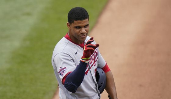 Washington Nationals' Juan Soto talks to someone while on first base during the eighth inning of a baseball game against the New York Mets at Citi Field, Thursday, Aug. 13, 2020, in New York. (AP Photo/Seth Wenig)