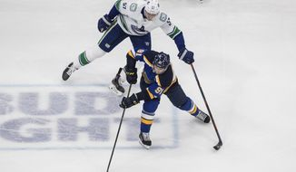 Vancouver Canucks' Tyler Myers (57) chases St. Louis Blues' Vladimir Tarasenko (91) during the second period in Game 1 of an NHL hockey Stanley Cup first-round playoff series, Wednesday, Aug. 12, 2020, in Edmonton, Alberta. (Jason Franson/The Canadian Press via AP)