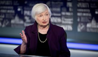 FILE - In this Aug. 14, 2019, file photo former Fed Chair Janet Yellen speaks with FOX Business Network guest anchor Jon Hilsenrath in the Fox Washington bureau in Washington. Former Federal Reserve Chair Janet Yellen was among a team of advisers who briefed Joe Biden on Thursday, Aug. 13, 2020, about the economic fallout from the coronavirus. (AP Photo/Andrew Harnik, File)