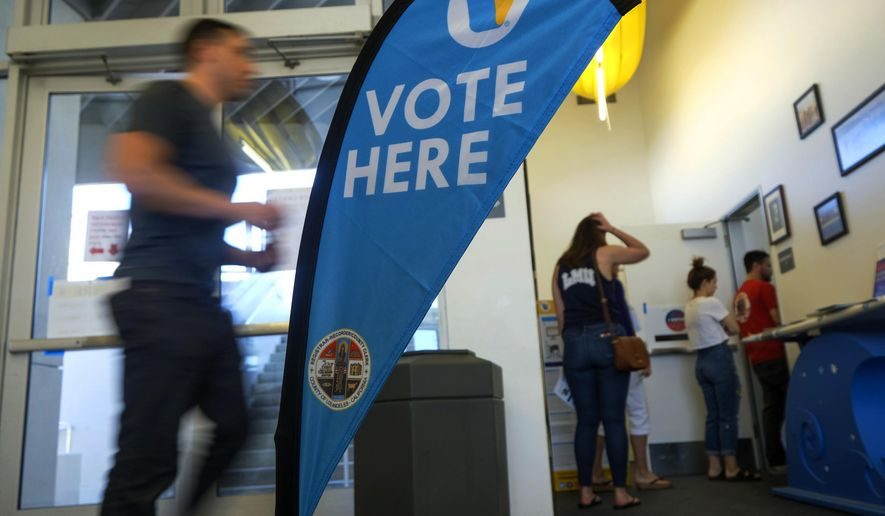 In this March 3, 2020 file photo, voters wait in line to cast their ballot on the Super Tuesday, at a voting center in El Segundo, Calif.  (AP Photo/Ringo H.W. Chiu, File)  **FILE**