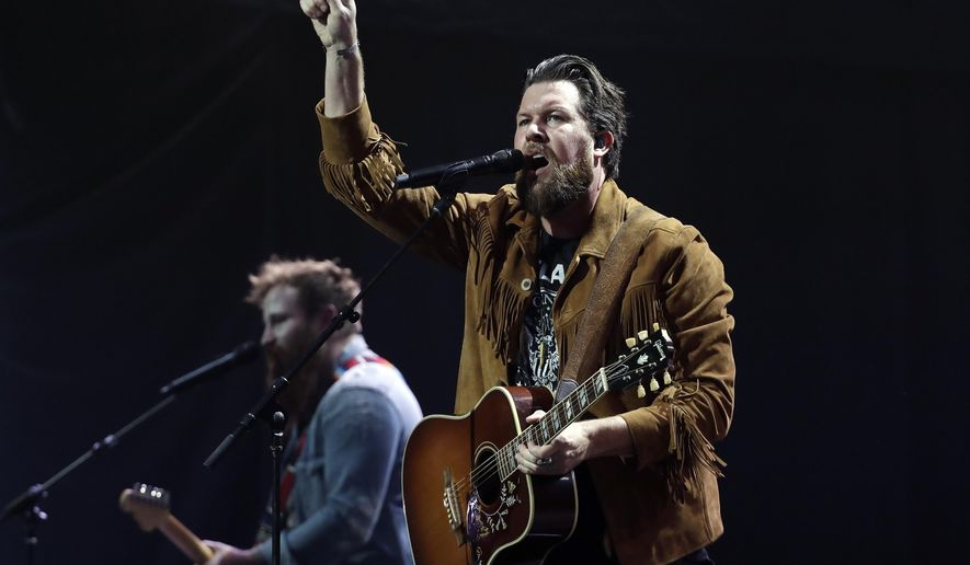 FILE - This Oct. 16, 2018 file photo shows Zach Williams performing during the Dove Awards in Nashville, Tenn.  Christian artists Zach Williams and for King & Country are the leading artist nominees at the 2020 Dove Awards, while rapper Kanye West and singer Gloria Gaynor earned their first ever nominations.(AP Photo/Mark Humphrey, File)