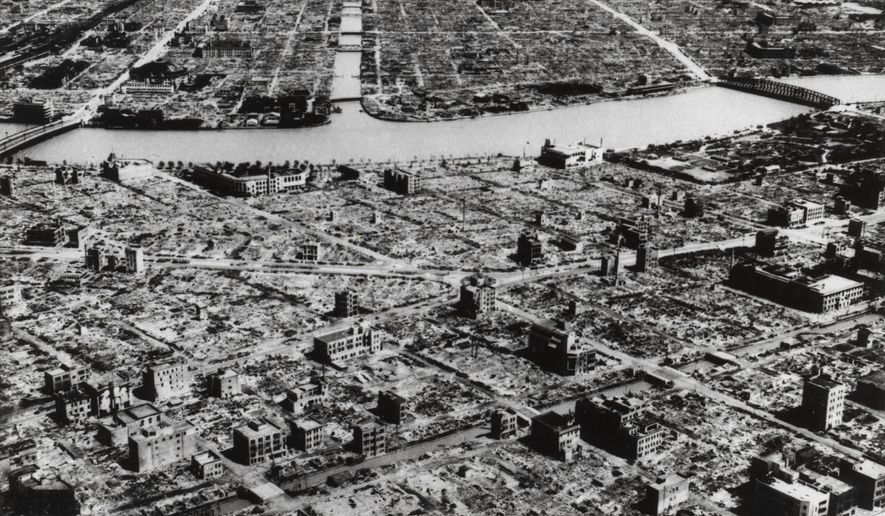 This aerial photo taken on March 9, 1945, shows the industrial section of Tokyo along the Sumida River. The nuclear bombs dropped by the United States on Hiroshima and Nagasaki in August 1945 secured Japan's surrender and ended World War II. In Japan, war orphans were punished for surviving. They were bullied. They were called trash, sometimes rounded up by police and put in cages. Some were sent to institutions or sold for labor. They were targets of abuse and discrimination. Now, 75 years after the war's end, some are revealing their untold stories of recovery and pain, underscoring Japan's failure to help its own people. (AP Photo, File)
