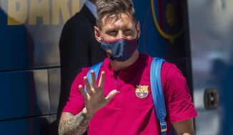 Barcelona's Lionel Messi waves as he arrives at the team hotel in Lisbon, Portugal, Thursday, Aug. 13, 2020. FC Barcelona are scheduled to play Bayern Munich in a Champions League quarterfinal soccer match on Friday. (AP Photo/Manu Fernandez)