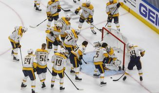 The Nashville Predators warm-up before taking on the Arizona Coyotes during NHL qualifying round game action in Edmonton, on Wednesday, Aug. 5, 2020. (Jason Franson/The Canadian Press via AP)