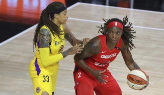 Los Angeles Sparks' Seimone Augustus (33) defends against Washington Mystics' Myisha Hines-Allen during the first half of a WNBA basketball game Thursday, Aug. 13, 2020, in Bradenton, Fla. (AP Photo/Mike Carlson) **FILE**