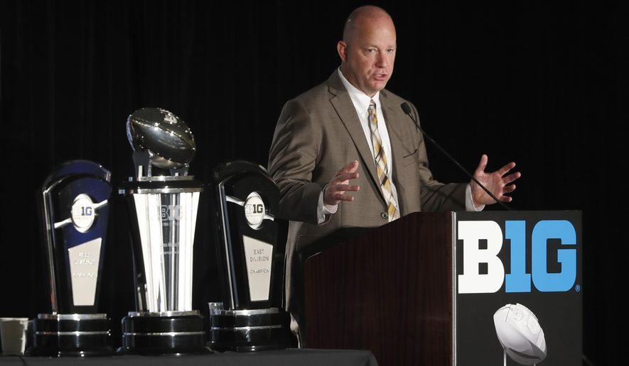 FILE - In this July 19, 2019, file photo, Purdue head coach Jeff Brohm responds to a question during the Big Ten Conference NCAA college football media days, in Chicago. Brohm believes college football can be played in the spring and next fall. And he even has a formal proposal. Just two days after the Big Ten announced it would postpone all fall sports, Brohm released a seven-page plan that calls for an eight-game conference only spring season followed by 10-game falls season. (AP Photo/Charles Rex Arbogast, File)