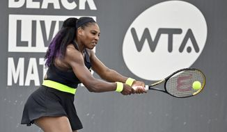 Serena Williams returns a shot to her sister Venus Williams during the WTA tennis tournament in Nicholasville, Ky., Thursday, Aug. 13, 2020. (AP Photo/Timothy D. Easley)