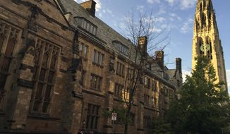 FILE - This Sept. 9, 2016 photo shows Harkness Tower on the campus of Yale University in New Haven, Conn. A Justice Department investigation has found Yale University is illegally discriminating against Asian-American and white applications, in violation of federal civil rights law, officials said Thursday, Aug. 13, 2020. (AP Photo/Beth J. Harpaz, File)