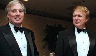 In this Nov. 3, 1999 file photo, Robert Trump, left, joins then real estate developer and presidential hopeful Donald Trump at an event in New York. President Donald Trump's younger brother, Robert Trump, has been hospitalized in New York, according to the White House.  The president is expected to visit his 72-year-old brother at a hospital in Manhattan on Friday.  (AP Photo/Diane Bonadreff, File)