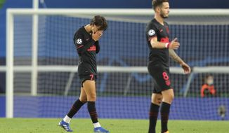 Atletico Madrid's Joao Felix is dejected after the Champions League quarterfinal match between RB Leipzig and Atletico Madrid at the Jose Alvalade stadium in Lisbon, Portugal, Thursday, Aug. 13, 2020. (Miguel A. Lopes/Pool Photo via AP)