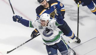 Vancouver Canucks' Bo Horvat (53) celebrates his goal as he is followed by St. Louis Blues' Alex Pietrangelo (27) during overtime in an NHL hockey Stanley Cup first-round playoff series, Friday, Aug. 14, 2020, in Edmonton, Alberta. (Jason Franson/The Canadian Press via AP)