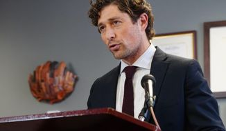 FILE - In this May 27, 2020, file photo, Minneapolis Mayor Jacob Frey calls on Hennepin County attorney Mike Freeman to charge the arresting officer in the death of George Floyd as he speaks during a news conference, at City Hall in Minneapolis. Mayor Frey on Friday, Aug. 14, 2020, announced plans to hold open 100 police officer positions next year as part of a hiring freeze to help manage a 2021 budget and as activists are clamoring to shift money away from traditional policing. (Evan Frost/Minnesota Public Radio via AP, File)