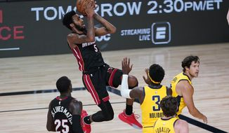 Miami Heat's Derrick Jones Jr. (5) shoots as Indiana Pacers' Aaron Holiday (3) defends during the first half of an NBA basketball game Monday, Aug. 3, 2020, in Lake Buena Vista, Fla. (AP Photo/Ashley Landis, Pool)