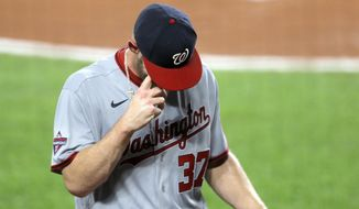 Washington Nationals starting pitcher Stephen Strasburg heads to the dugout after leaving the game during the first inning of a baseball game against the Baltimore Orioles, Friday, Aug. 14, 2020, in Baltimore. (AP Photo/Julio Cortez)