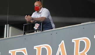Washington Nationals general manager Mike Rizzo looks on during the seventh inning in the continuation of a suspended baseball game between the Baltimore Orioles and the Nationals, Friday, Aug. 14, 2020, in Baltimore. The first part of the game was suspended on Aug. 9, when the groundskeepers had technical difficulties with the infield tarp in the sixth inning during a rain delay, causing the infield to become too wet and muddy to play. (AP Photo/Julio Cortez)