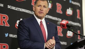 FILE - In this Dec. 4, 2019, file photo, Rutgers NCAA college football head coach Greg Schiano speaks at an introductory news conference in Piscataway, N.J. Rutgers has had at least 30 football players tested positive for COVID-19 since the team returned to campus in mid June. Schiano released the information on Friday, Aug. 14, 2020, in his first conference call since the Big Ten Conference decided not to play football this fall. (AP Photo/Seth Wenig, File)