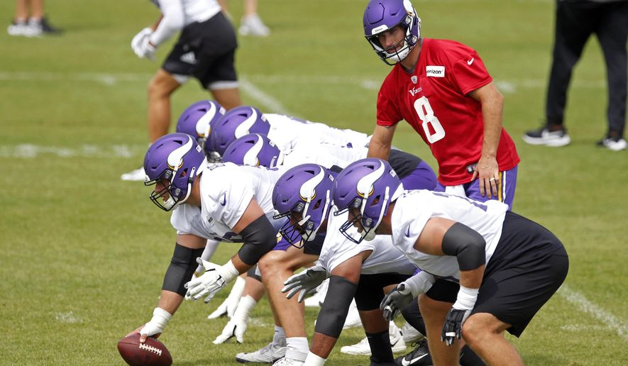 Minnesota Vikings quarterback Kirk Cousins (8) prepares for a pass play during the NFL football team's practice Friday, Aug. 14, 2020, in Eagan, Minn. (AP Photo/Jim Mone)