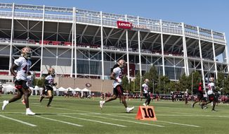 San Francisco 49ers cornerback Richard Sherman (25), center, works out during NFL football training camp practice Saturday, Aug. 15, 2020, at the SAP Performance Facility in Santa Clara, Calif. (Xavier Mascarenas/The Sacramento Bee via AP, Pool)