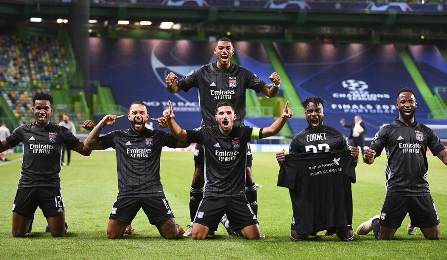 Lyon players celebrate after winning the Champions League quarterfinal match against Manchester City at the Jose Alvalade stadium in Lisbon, Portugal, Saturday, Aug. 15, 2020. (Franck Fife/Pool Photo via AP)