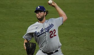 Los Angeles Dodgers starting pitcher Clayton Kershaw throws against the Los Angeles Angels during the fourth inning of a baseball game, Friday, Aug. 14, 2020, in Anaheim, Calif. (AP Photo/Jae C. Hong)