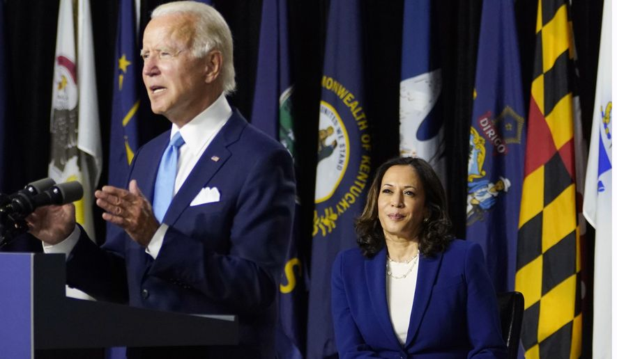 Democratic presidential candidate former Vice President Joe Biden, joined by his running mate Sen. Kamala Harris, D-Calif., speaks during a campaign event at Alexis Dupont High School in Wilmington, Del., Wednesday, Aug. 12, 2020. (AP Photo/Carolyn Kaster) **FILE**