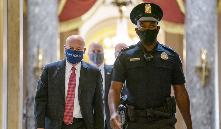 In this Aug. 5, 2020, file photo Postmaster General Louis DeJoy, left, is escorted to House Speaker Nancy Pelosi's office on Capitol Hill in Washington. (AP Photo/Carolyn Kaster, File)
