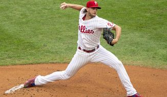 Philadelphia Phillies starting pitcher Aaron Nola throws a pitch during the first inning of a baseball game against the New York Mets, Saturday, Aug. 15, 2020, in Philadelphia. (AP Photo/Chris Szagola)