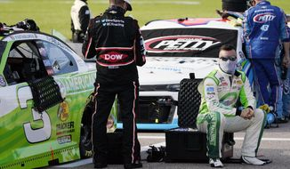 Driver Austin Dillon sits next to his car before a NASCAR Cup Series auto race at Kansas Speedway in Kansas City, Kan., Thursday, July 23, 2020. (AP Photo/Charlie Riedel)