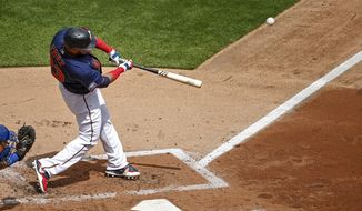Minnesota Twins' Nelson Cruz hits a two run homer against the Kansas City Royals in the third inning of game one of a baseball double-header Saturday, Aug. 15, 2020, in Minneapolis. (AP Photo/Bruce Kluckhohn)