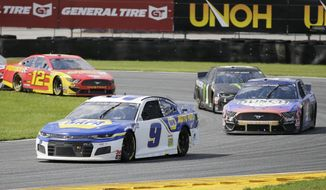 Chase Elliott (9) leads Kevin Harvick (4), Kurt Busch (1) and Ryan Blaney through Turn 3 during a NASCAR Cup Series auto race at Daytona International Speedway, Sunday, Aug. 16, 2020, in Daytona Beach, Fla. (AP Photo/Terry Renna)