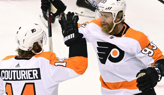 Philadelphia Flyers right wing Jakub Voracek (93) celebrates his goal against the Montreal Canadiens with Sean Couturier (14) during the first period of Game 3 of an NHL hockey playoff first-round series Sunday, Aug. 16, 2020, in Toronto. (Frank Gunn/The Canadian Press via AP)